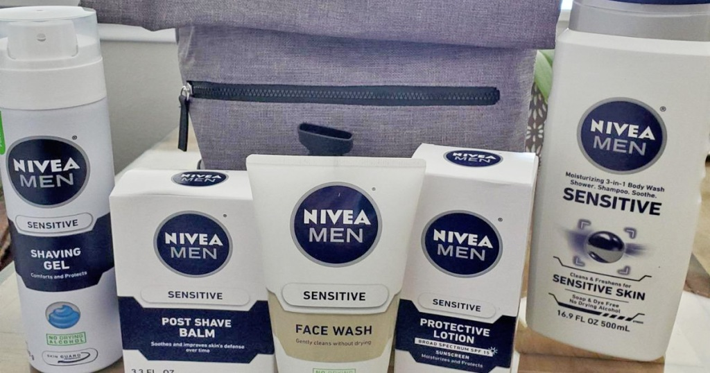 white and blue bottles of nivea men's personal care products and grey travel bag behind them