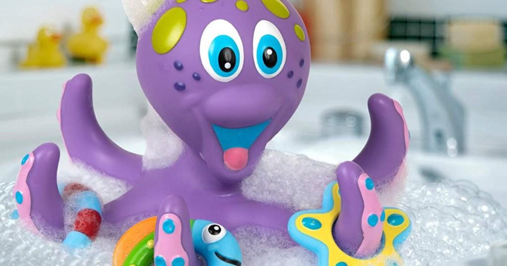 purple octopus toy in bubble bath