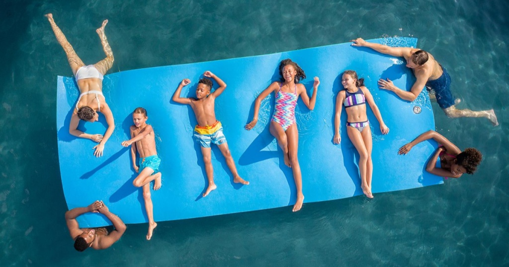 kids and adults on blue float in water