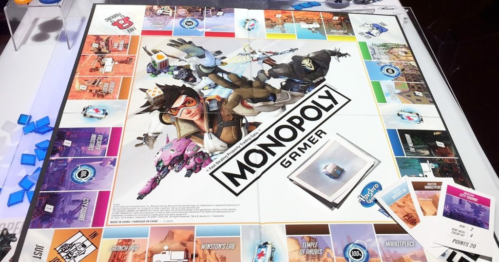 monopoly overwatch edition board game set up with game pieces and cards