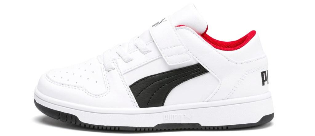 little boys white velcro sneaker with black puma logo on side