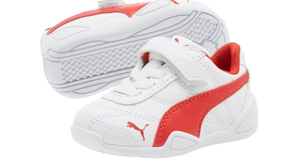 white leather toddler shoes with velcro strap and red accents
