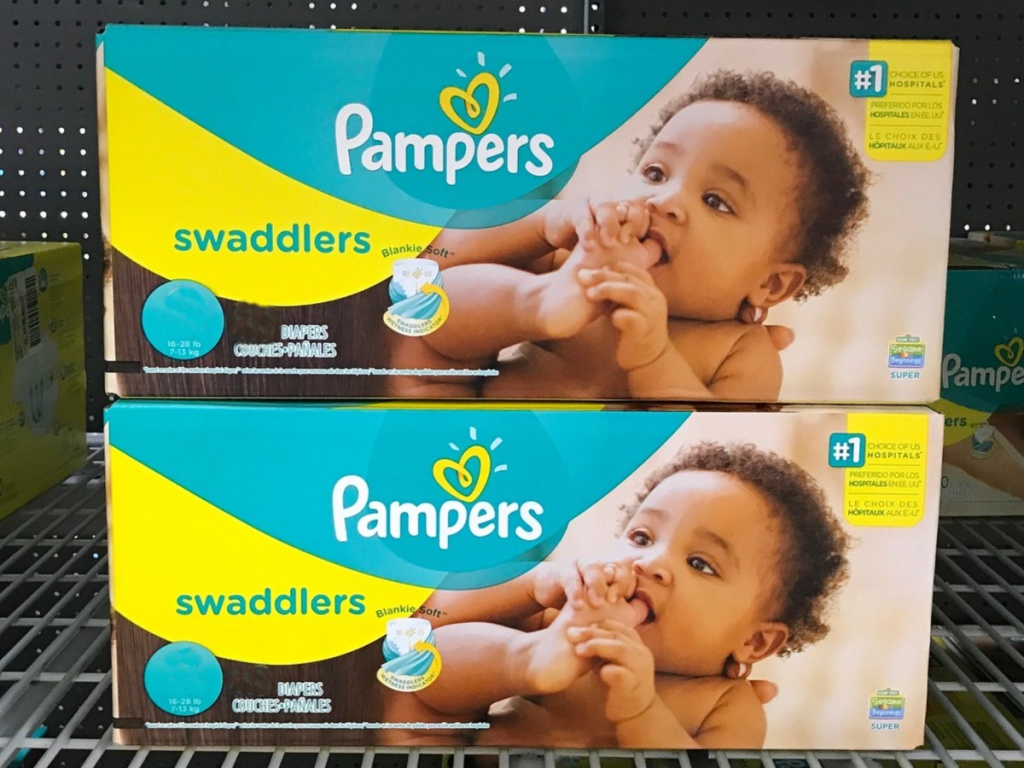 two boxes of pampers swaddlers diapers with a picture of a baby on the front sitting on a shelf