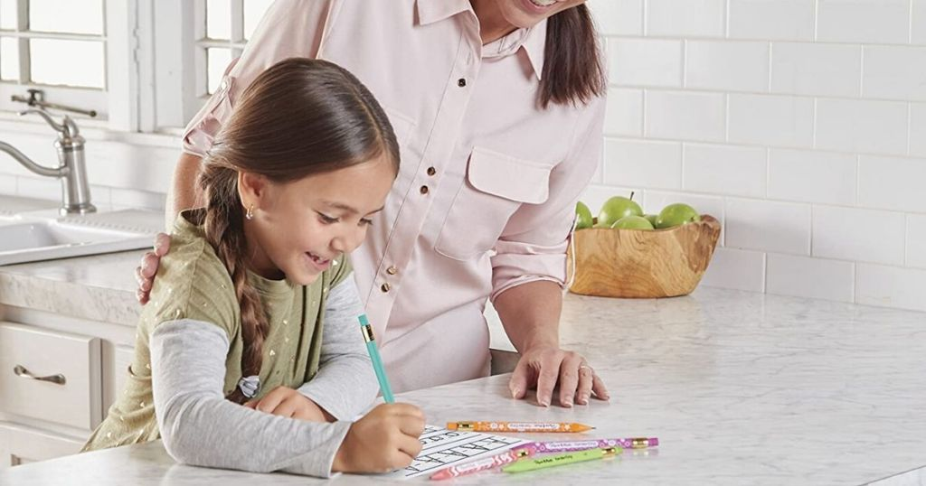 Young girl with mom, writing with papermate mechanical pencils