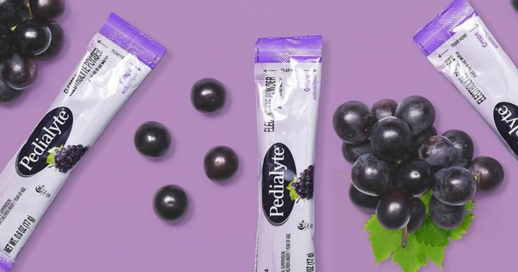 Pedialyte grape packets next to grapes