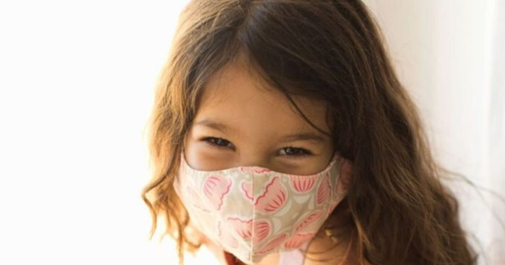 child wearing protective face mask