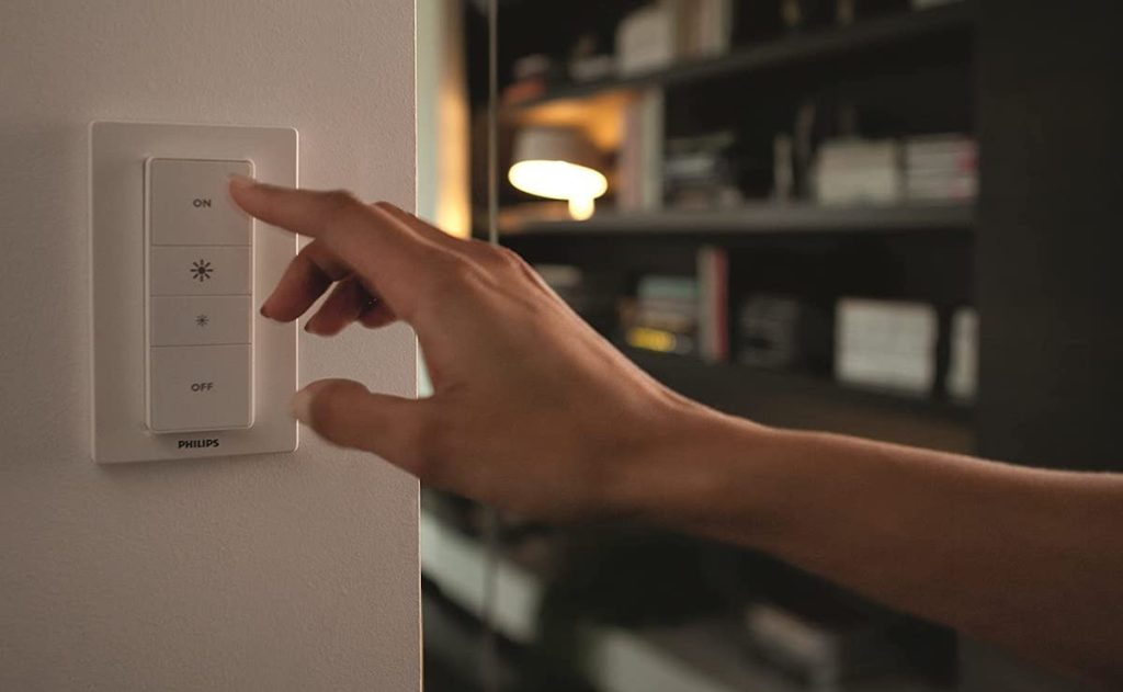hand pressing on a light switch