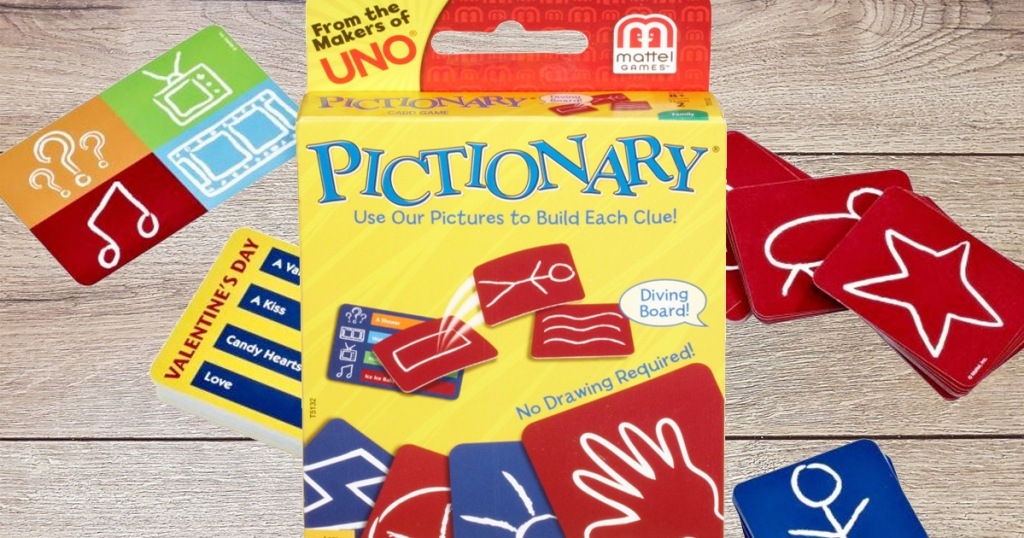 yellow box for pictionary card game with cards behind it on wooden table