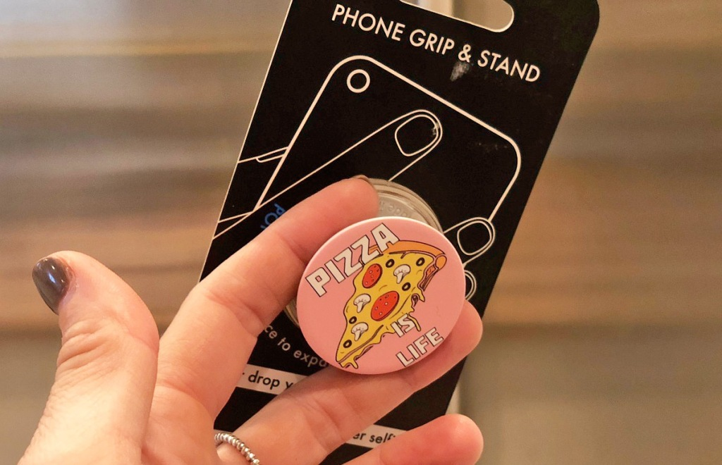 person holding up a pink pizza is life popsocket