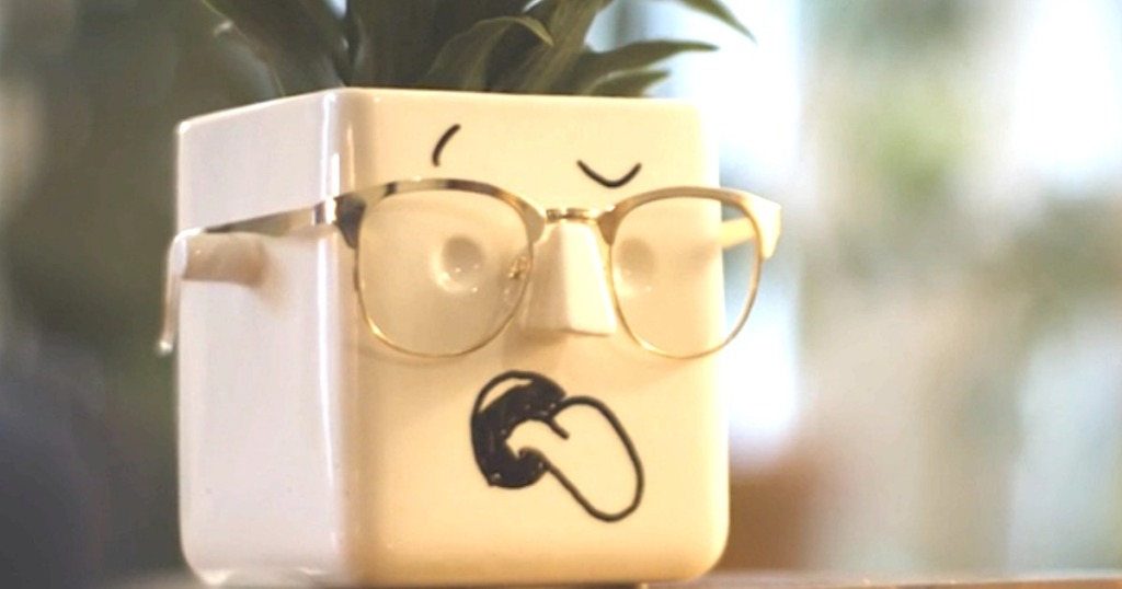 face planter with tongue sticking out and glasses on