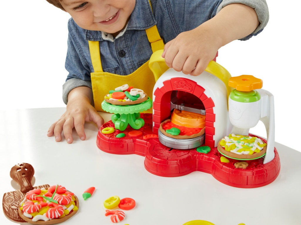 little boy playing with pizza oven play-doh set