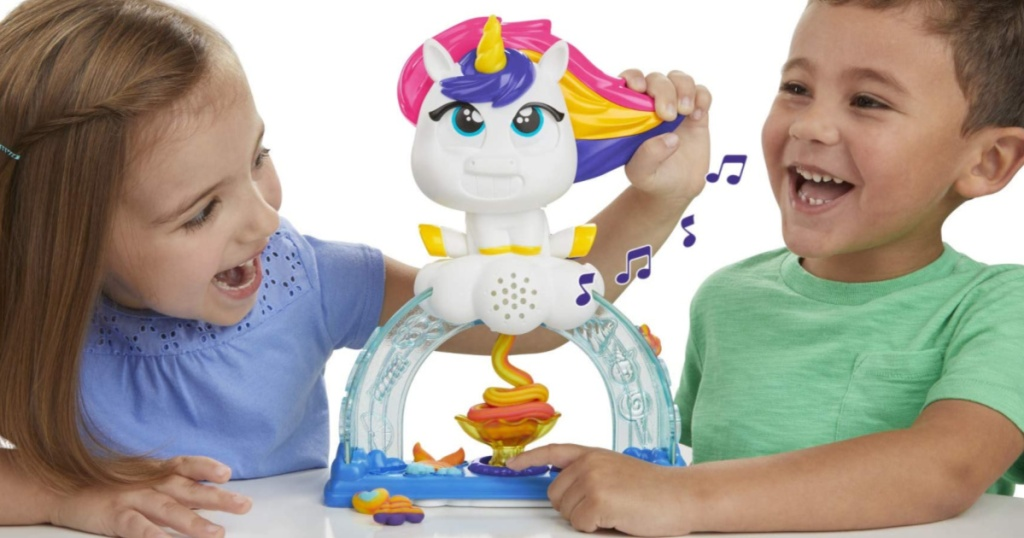 2 kids playing with a play-doh unicorn set