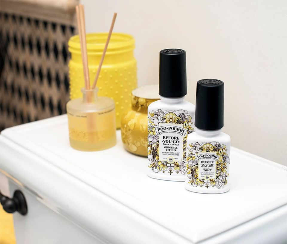 Poo-Pourri Citrus and candles on toilet