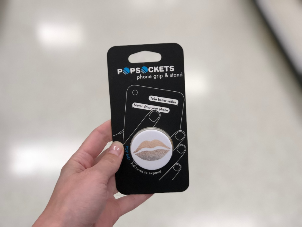 hand holding popsocket with lips