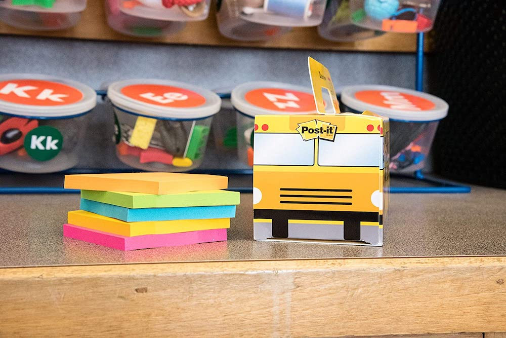 Post-It Value Pack Bus next to stack of sticky notes on table