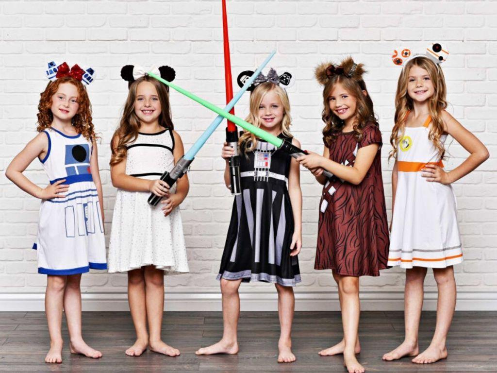 five little girls wearing star wars inspired dresses