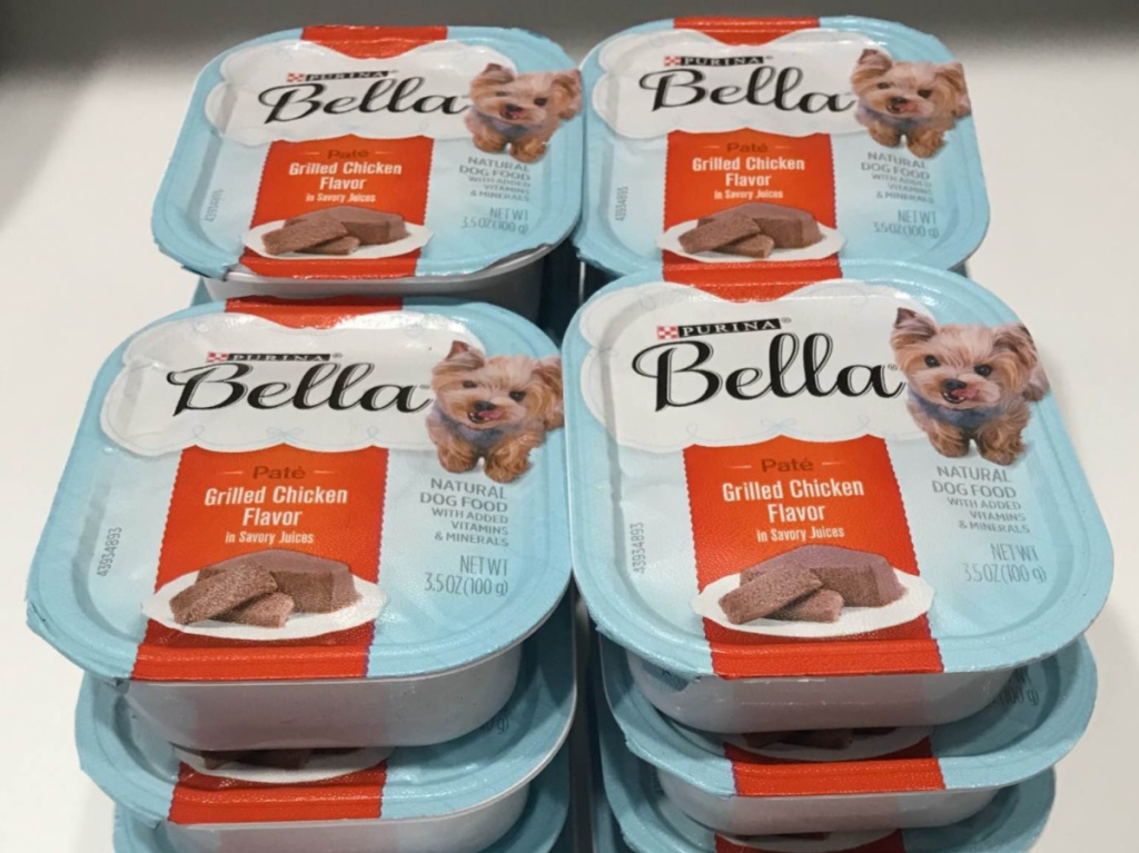 stack of small trays of grilled chicken flavor dog food