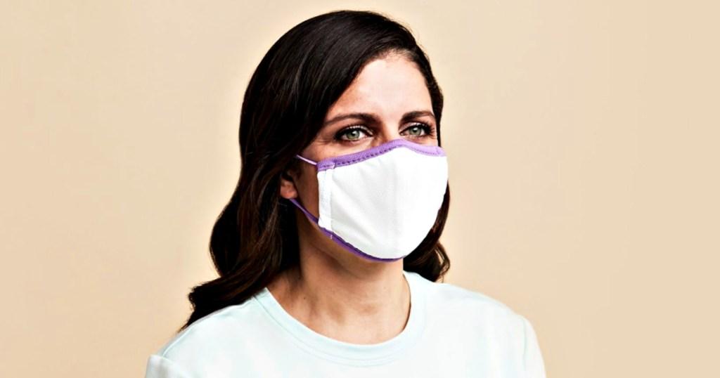 Purple face mask on woman