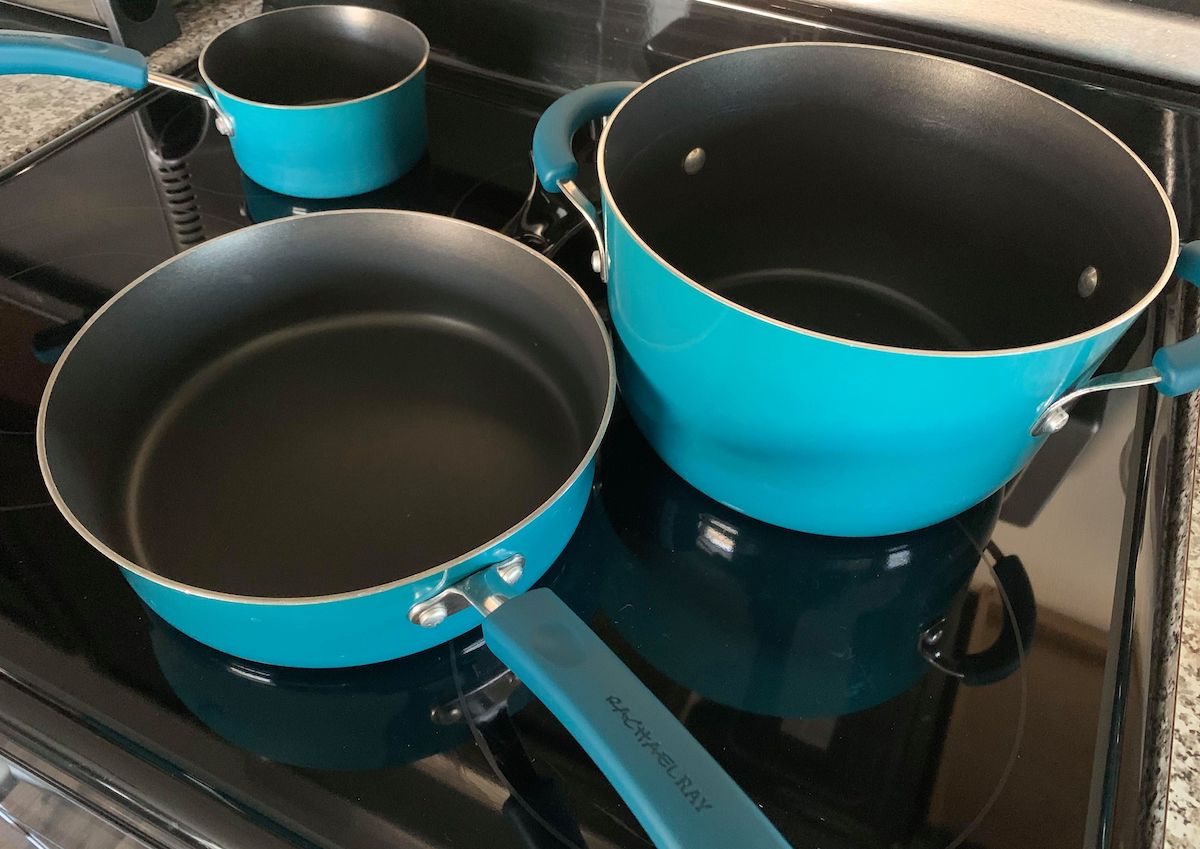 blue pots and pans on stovetop