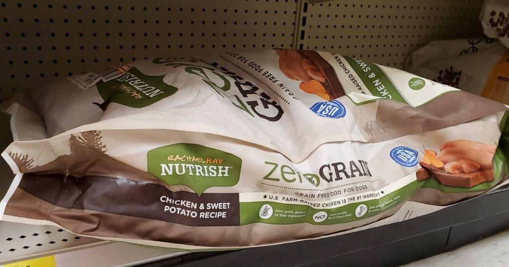 huge bag of dog food on bottom shelf at store