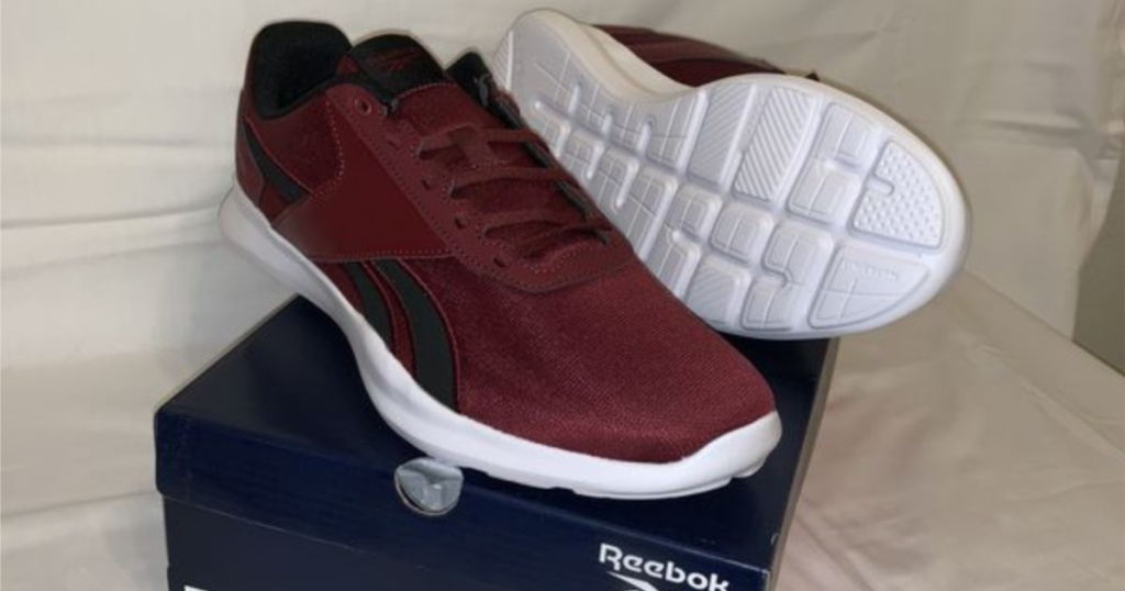 men's maroon and black sneakers on shoe box