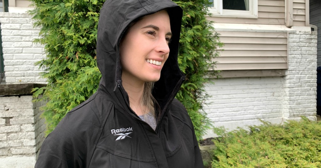 woman wearing reebok jacket with hood on