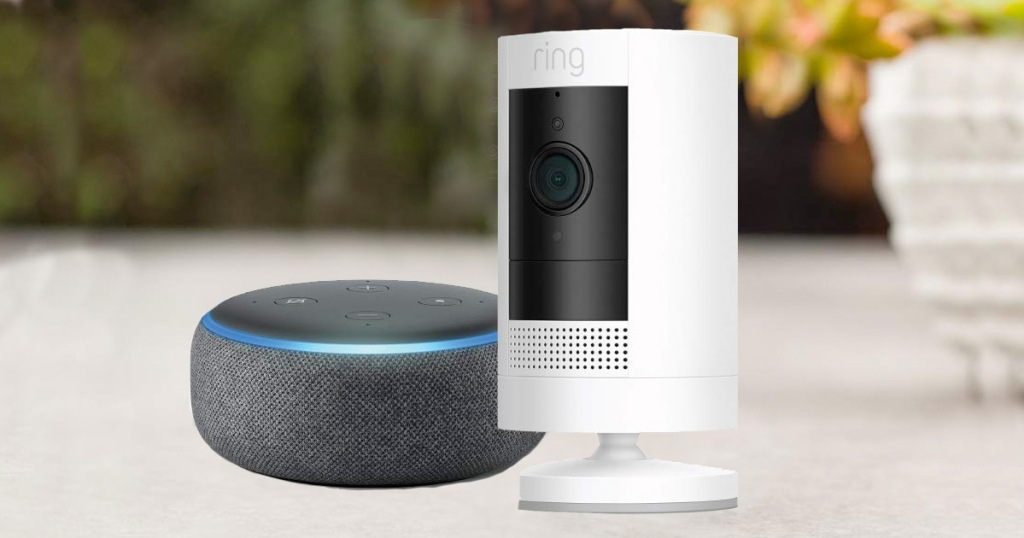 white ring stick up camera next to grey echo dot