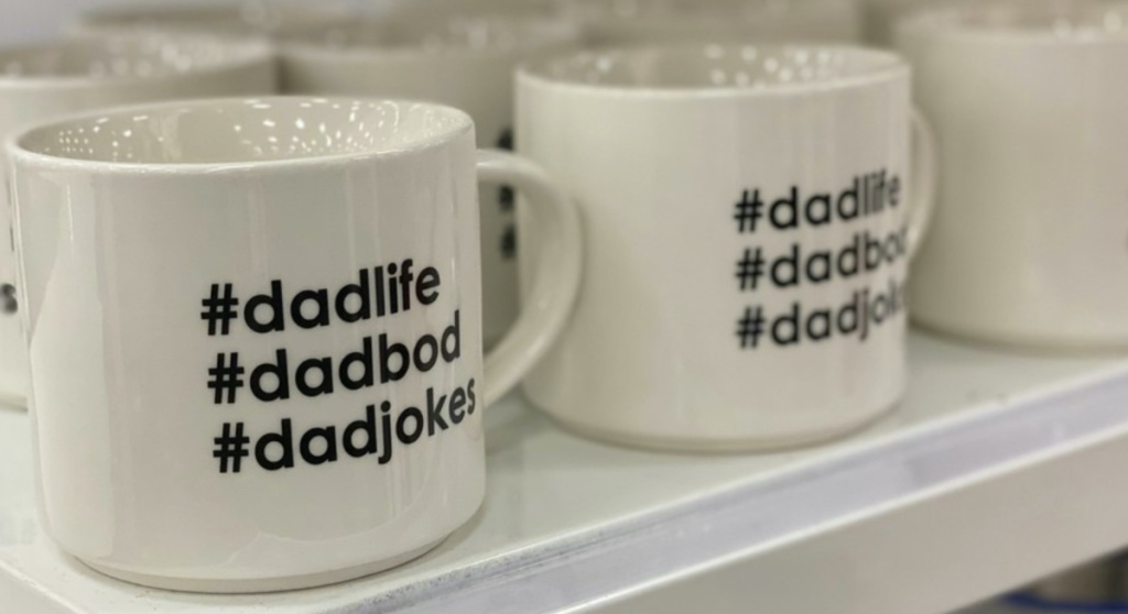 white Father's Day theme mugs on store shelf