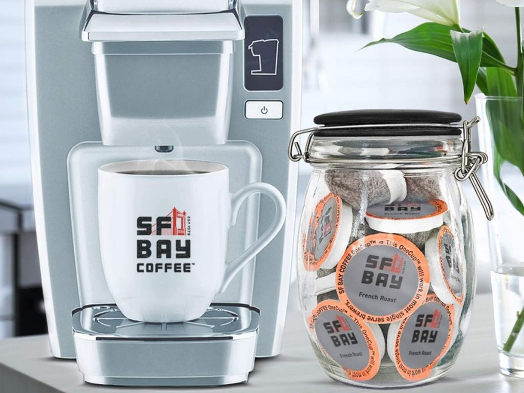 single cup coffee maker and jar of coffee pods