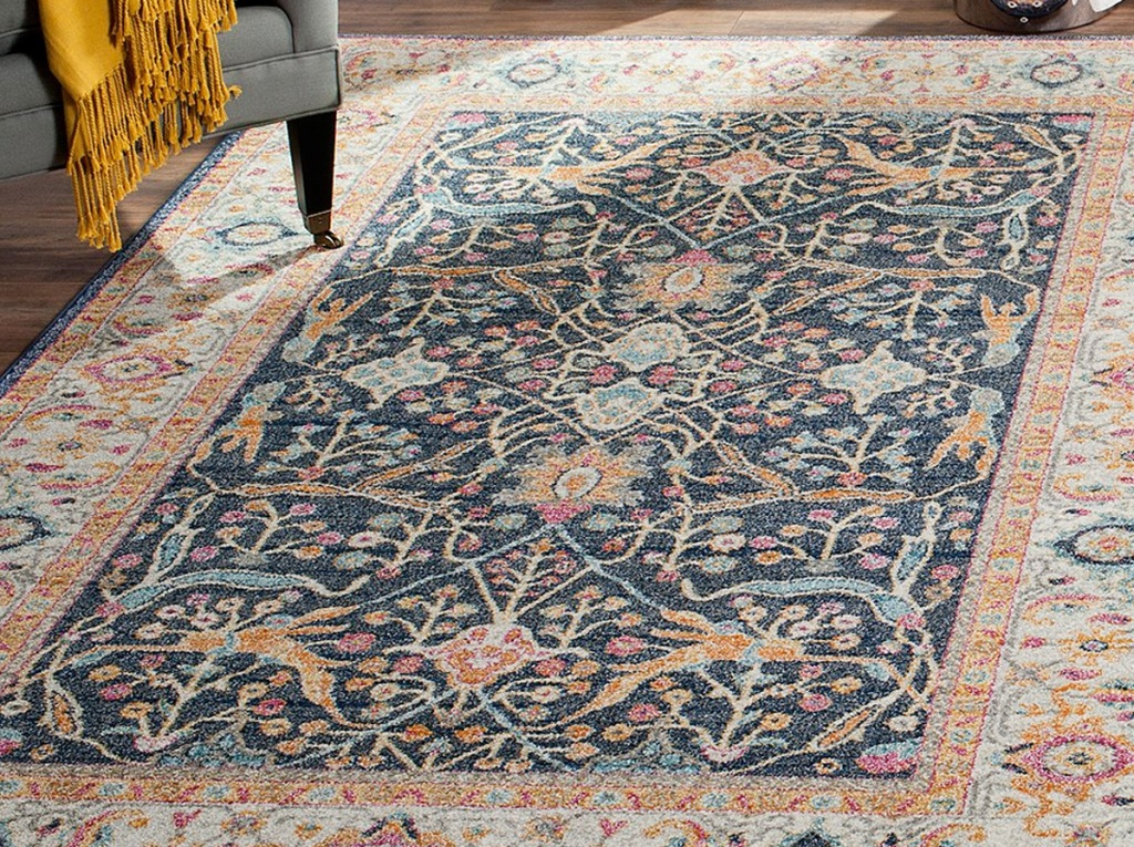 blue and cream colored oriental pattern area rug