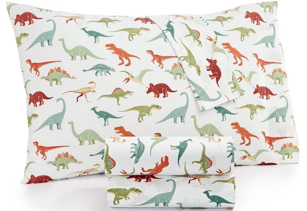 dinosaur sheet set and pillowcase on a pillow