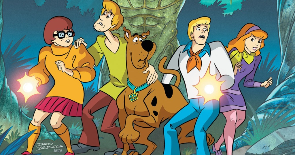 Scooby-Doo gang in front os swamp monster