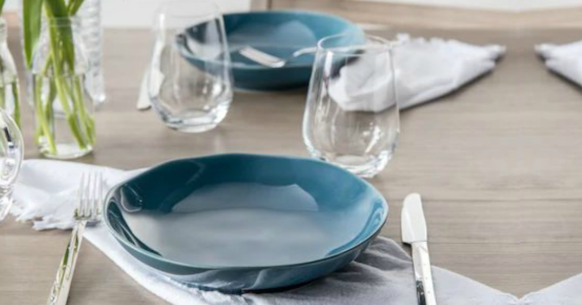 bowls glasses and flatware on a table