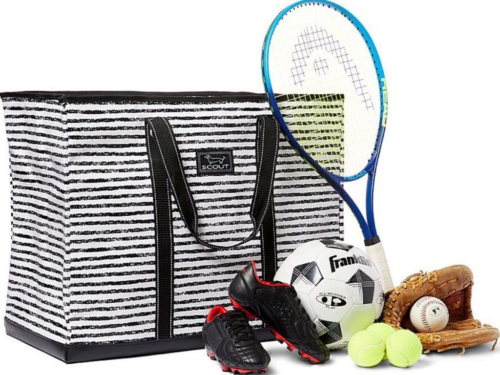 giant tote bag with cleats, tennisballs, soccer ball, baseball mitt with baseball in it and tennis racket