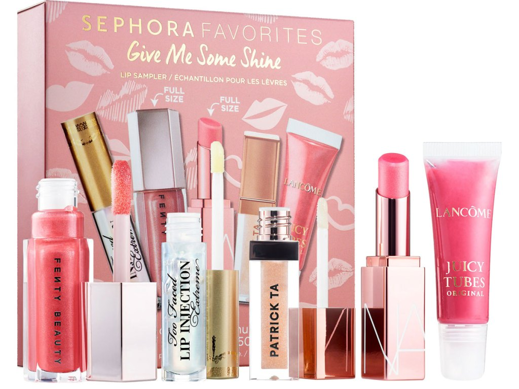 various trial size samples of lip products with pink box