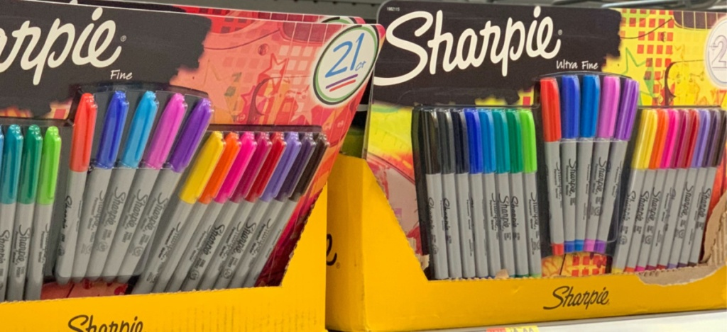 21-count packages of various colored permanent markers in boxes on store shelf