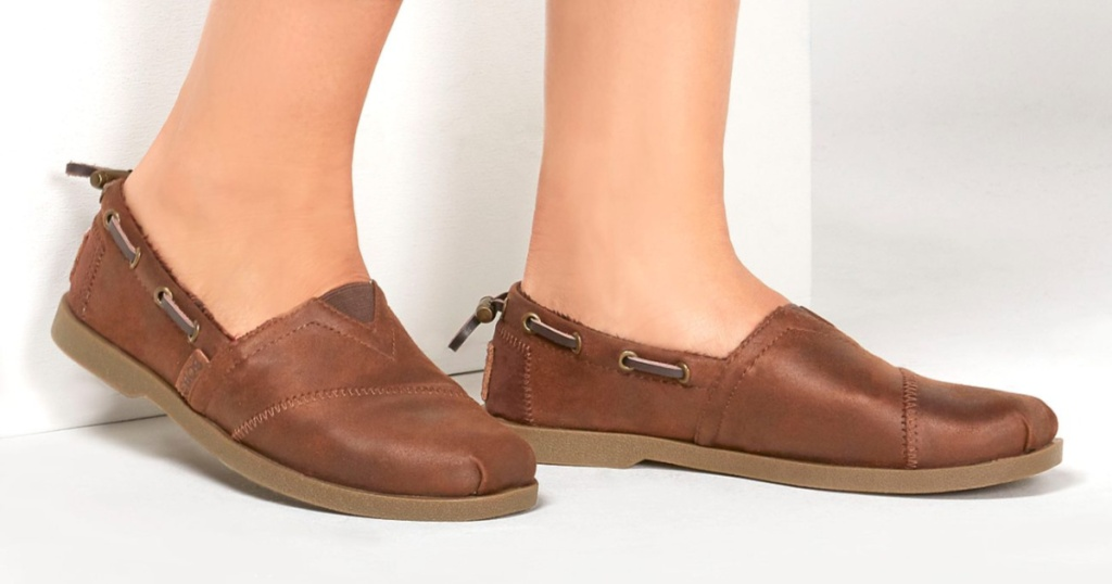 woman in brown slip on shoes