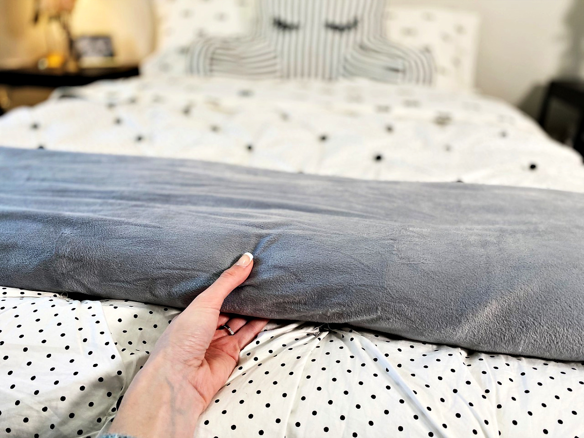 Sleep Mantra Weighted Blanket layed out on bed