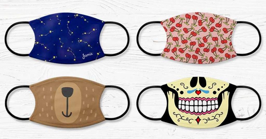 four custom photo face masks with black elastic straps on white wood background