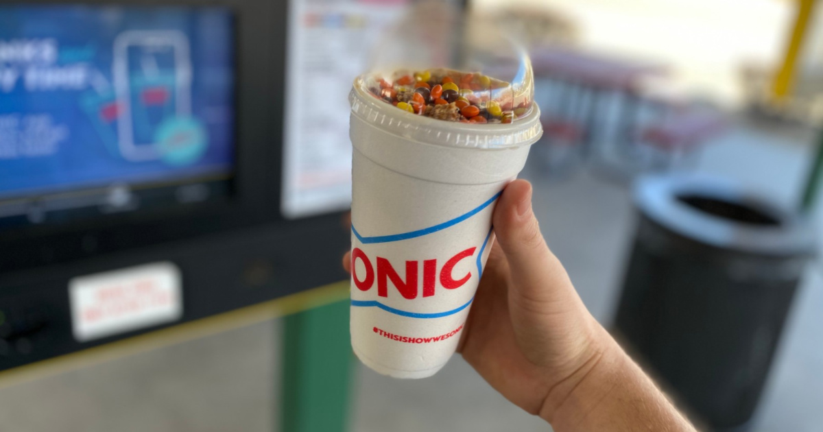 person holding a blast ice cream drink from Sonic