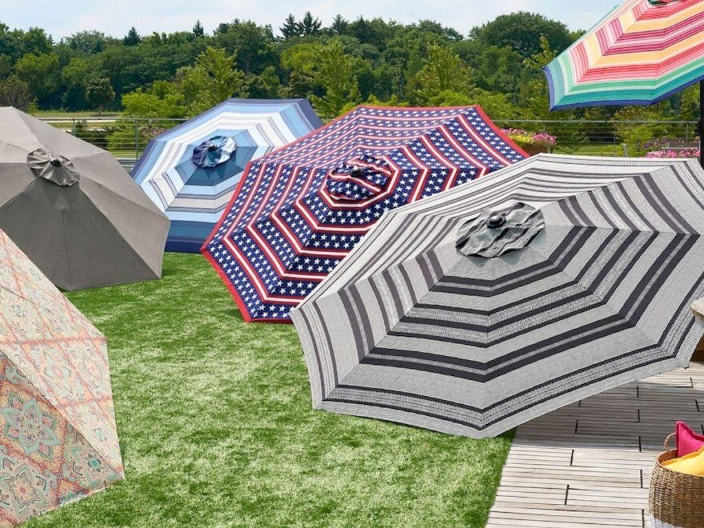 six 9-ft. tiltable umbrellas open on display outside
