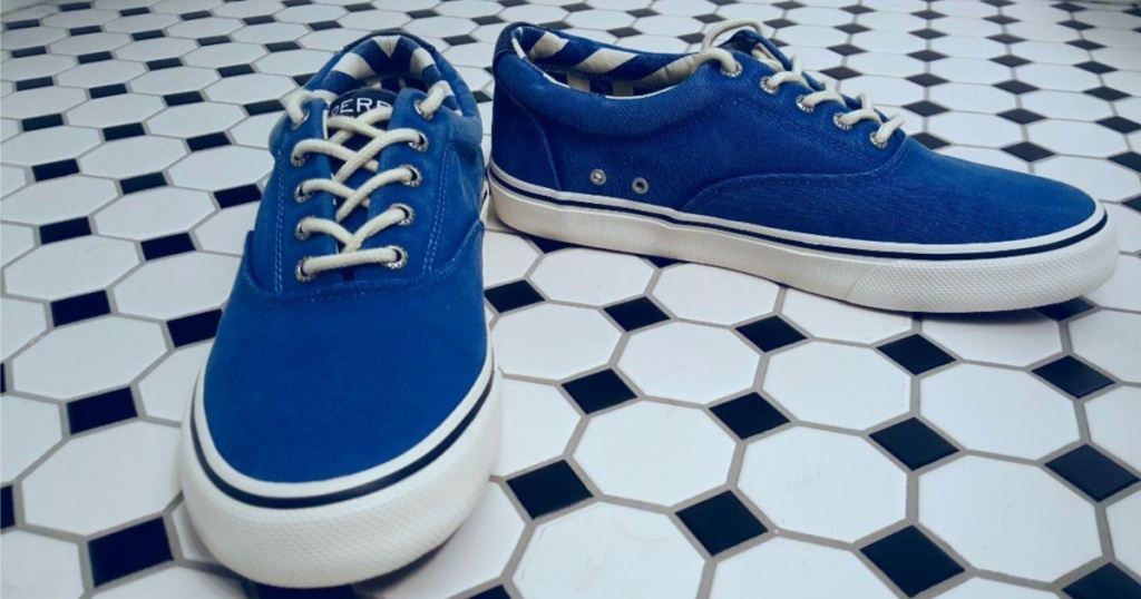 blue sneakers on black and white tile