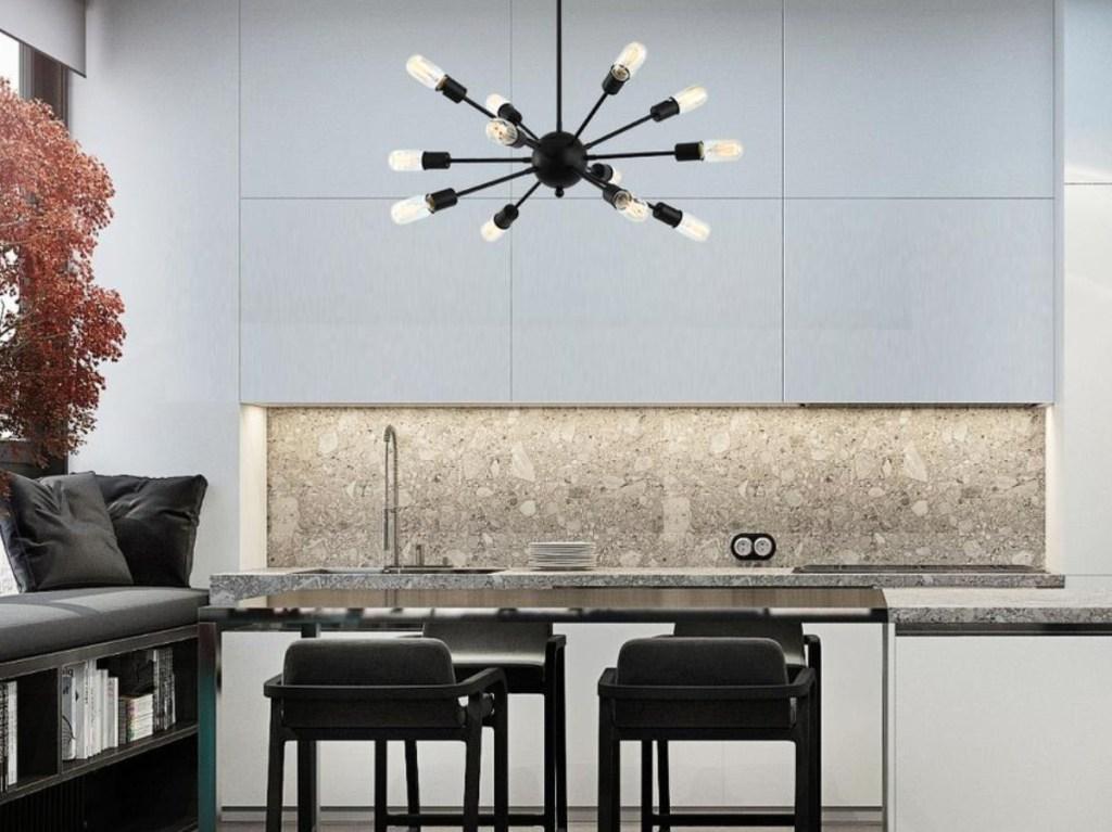 black sputnik style chandelier hanging from a kitchen ceiling