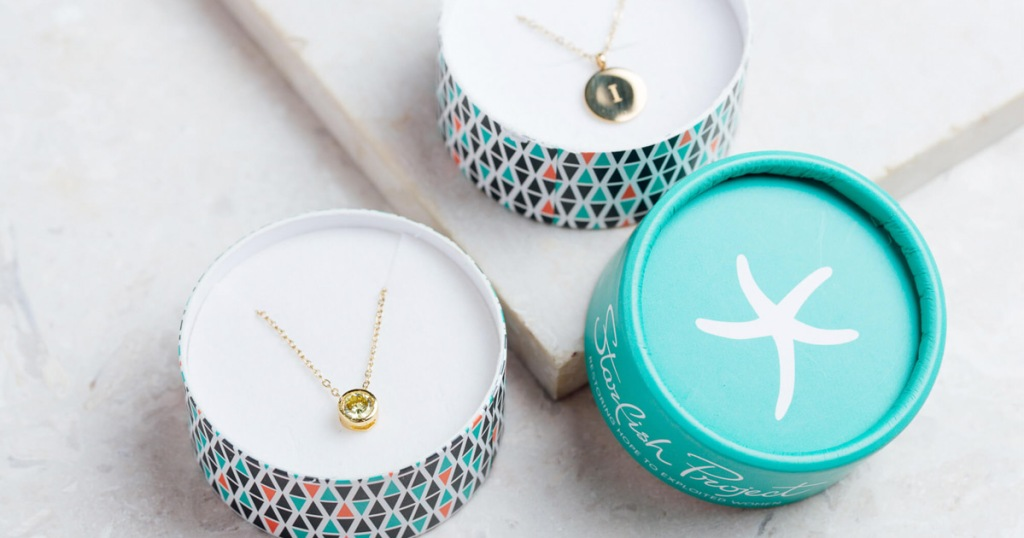 pendant necklaces in round gift boxes and a teal lid with a white starfish on top