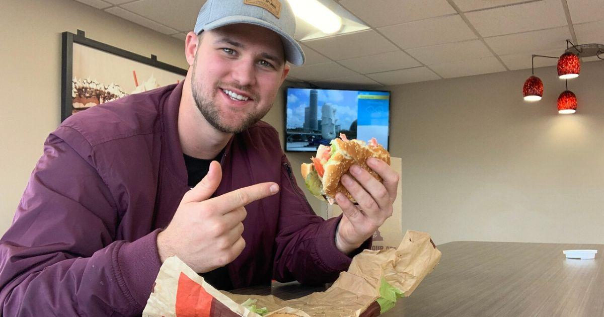 man eating whopper at Burger King