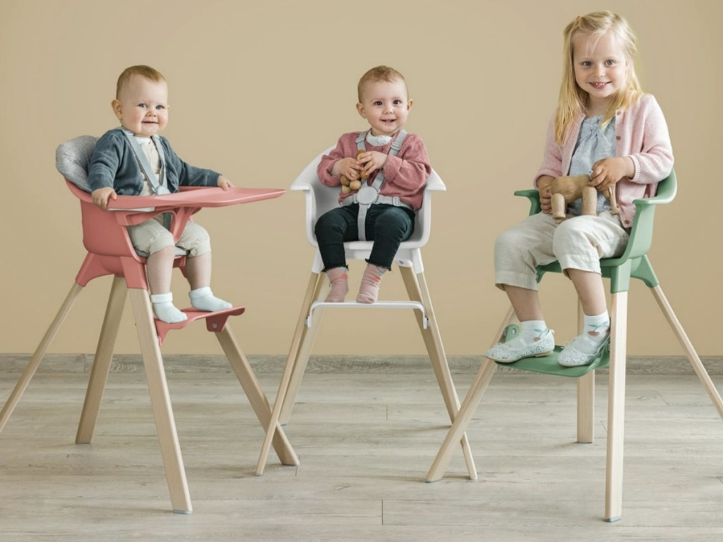 Kids sitting in stokke high chairs