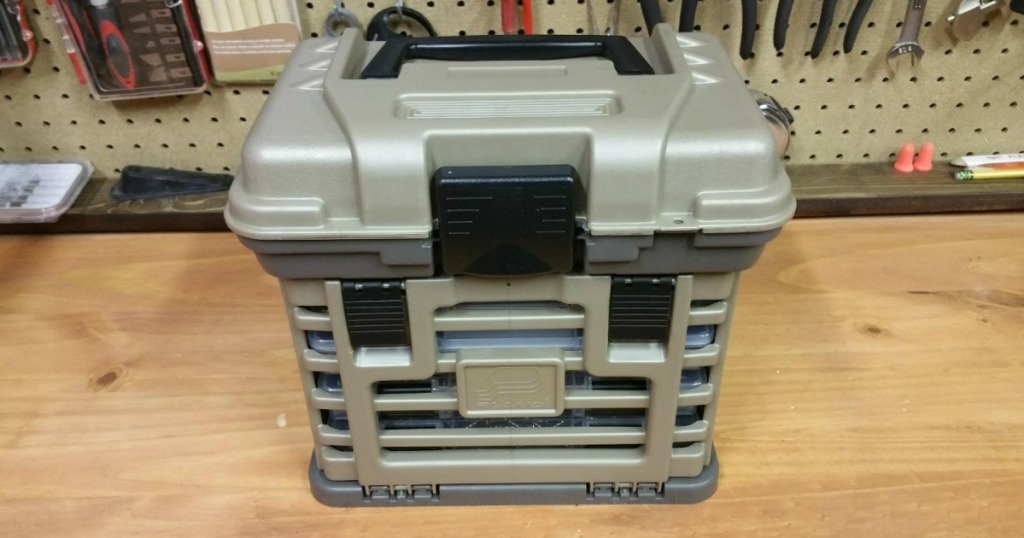 Small durable toolbox with additional storage space on counter in garage