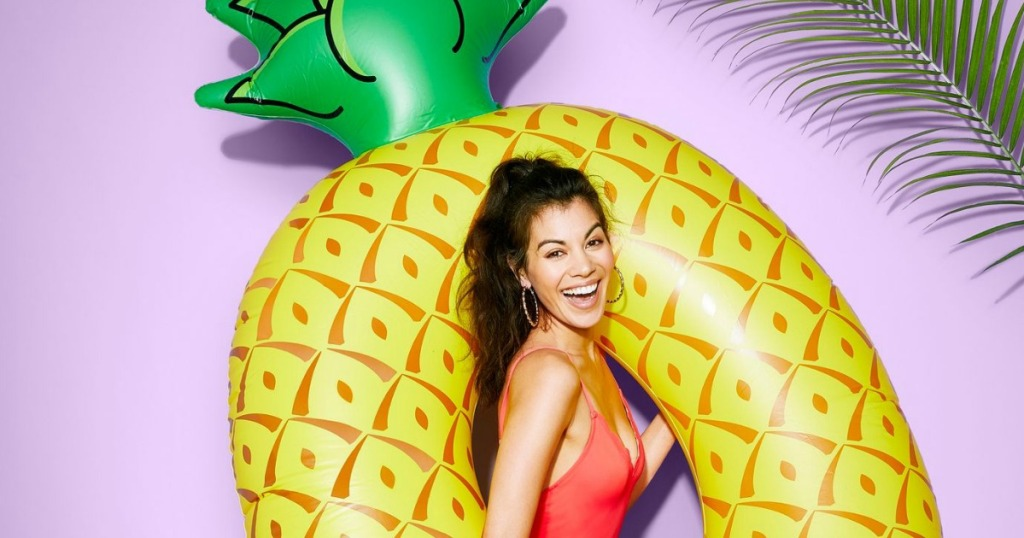 woman in a pineapple pool float
