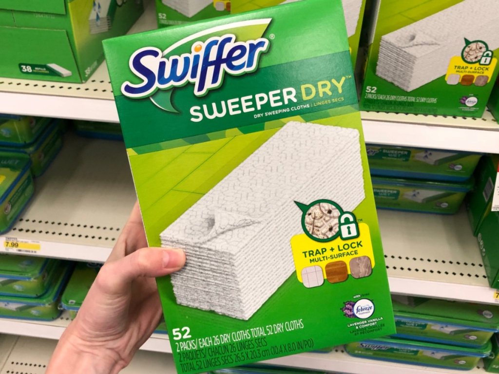 hand holding box of Swiffer dry mop refills in store