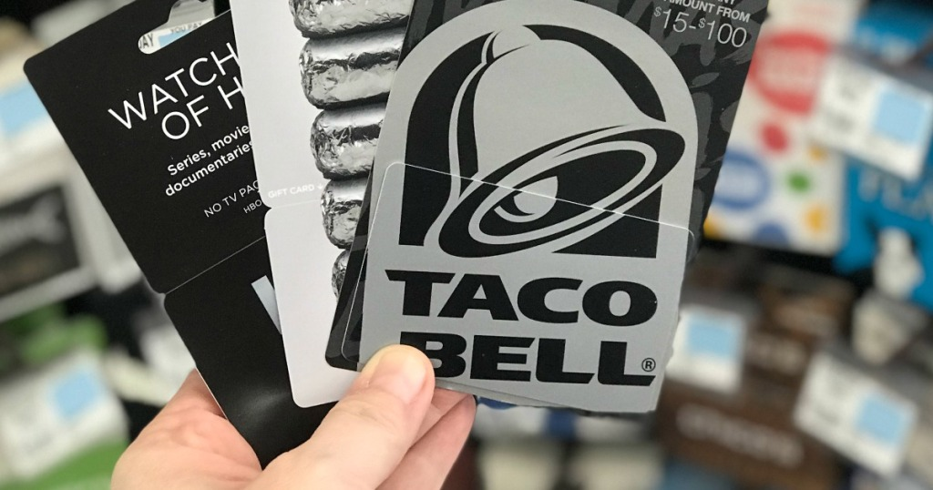 Man holding Taco Bell gift card